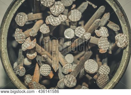 Old Iron Nails Close-up In An Iron Jar. Iron Pin Covered With Dust And Rust. Selective Focus, Grain