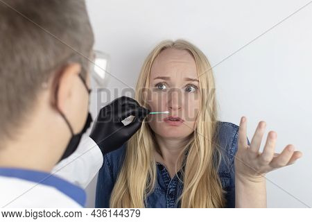 The Girl Complains To The Doctor About The Loss Of Smell. The Doctor Conducts A Sense Of Smell Test.