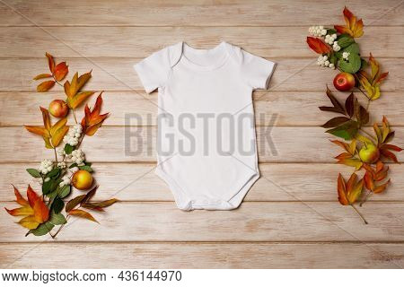 White Baby Short Sleeve Bodysuit Mockup With Snowberry And Fall Leaves