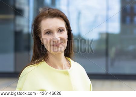 Smiling Middle Aged Woman. Elderly Businesswoman Near Business Center. Lecturer, Teacher At Universi