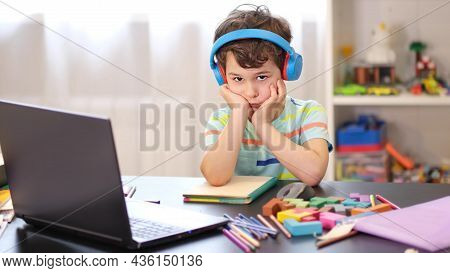 Learn On Your Schedule. Distance Learning Online Education. Tired Sad Boy Studying At Home Online On