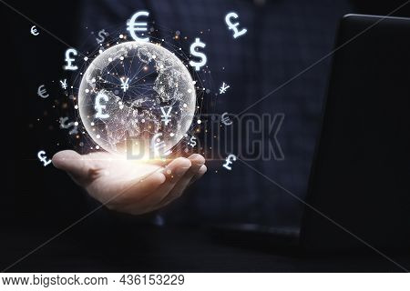 Businessman Holding Virtual Earth With Currency Sign And Connection During Use Computer Laptop Tradi
