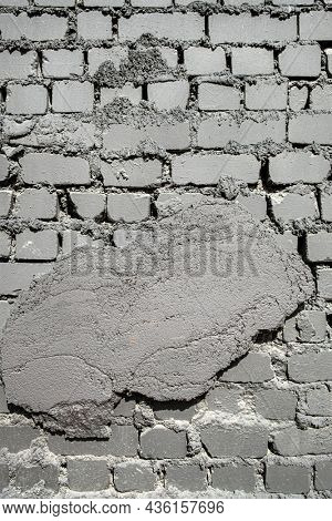 Old grungy  grey brick wall background.