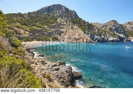 Turquoise Waters In Mallorca. Coll Baix Beach. Mediterranean Coastline. Spain