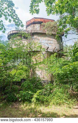 Wladyslawowo, Poland - July 21, 2021: Historical Bunker Over Trees At Hel Peninsula Near Baltic Sea.