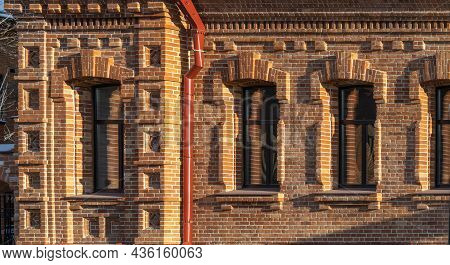 Three Windows Of The Old Mansion 19 Century With Brown Bricks Wall. Brick Wall Of An Old 19th Centur