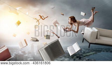 Young woman levitates while reading a book . Mixed media