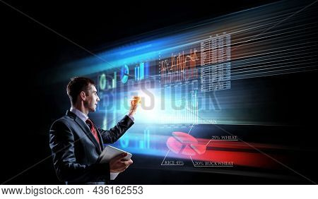 Business graph and trade monitor . Mixed media