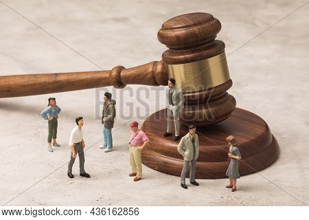Toy Men Made Of Plastic And A Judge's Gavel On The Table, A Concept On The Topic Of Administrative O