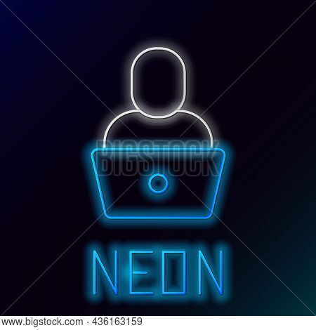 Glowing Neon Line Freelancer Icon Isolated On Black Background. Freelancer Man Working On Laptop At