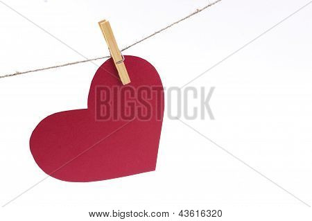 Red Paper Heart On A Clothespin