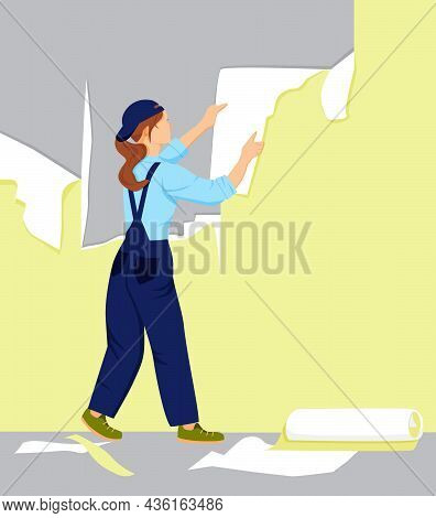 A Girl Tears Off The Old Wallpaper From The Wall. A Woman Makes Repairs In The Home. Apartment Or Ho