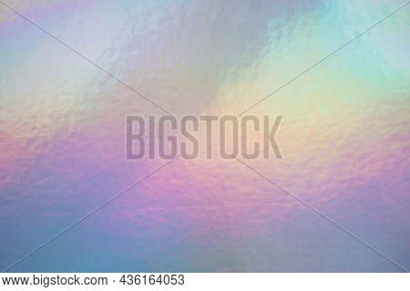 Iridescent Holographic Foil Background. Soft Pastel Colors Backdrop. Trendy Creative Gradient.