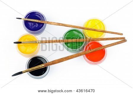 Arrangement of Containers with Black Orange Blue and Red Green Yellow Watercolors and Three Paintbrushes isolated on white background. Top View poster