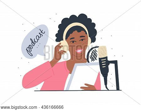 Dark-skinned Young Woman Is Recording A Podcast. An African-american Woman With Headphones And A Mic