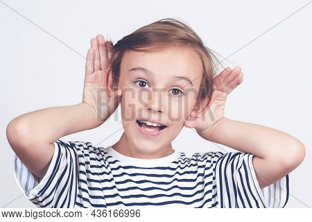 Child Hearing Gossip At School. Face Expression And Gesture. Cute Boy Holds Hand Near Ear. Funny Kid