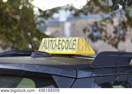 Yellow Car Roof Sign With Written In It In French