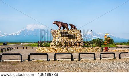 Yelizovo, Russia - July 17, 2018: Monument She Bear With The Cub On The Background Of The Volcanoes.