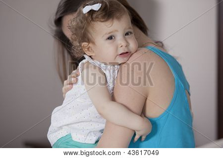 Mom comforting her baby girl