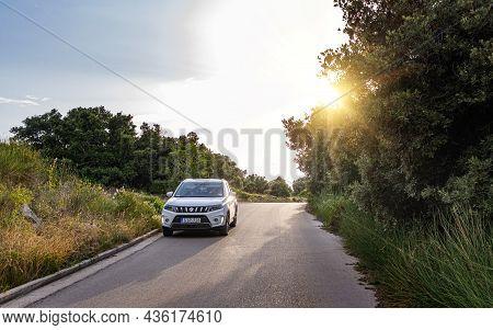 Vir, Croatia - July 27, 2021: White Suzuki Vitara On The Road At The Island Of Vir, Croatia.