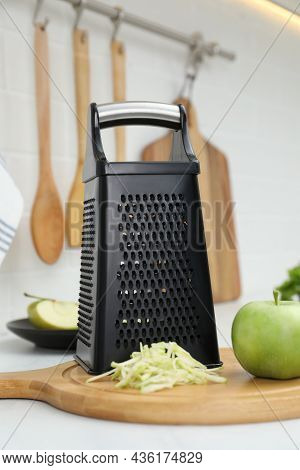 Grater And Fresh Ripe Apple On Kitchen Counter