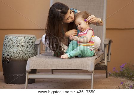 Mom and baby girl outdoors