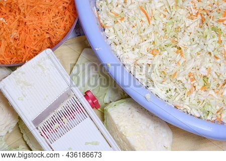 Heads Of Cabbage And Slicing Grater Close-up And Carrots