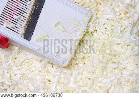 Background Of Thinly Sliced Sauerkraut And Grater