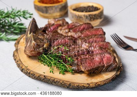 Sliced Medium Rare Grilled Beef Steak On Wooden Cutting Board With