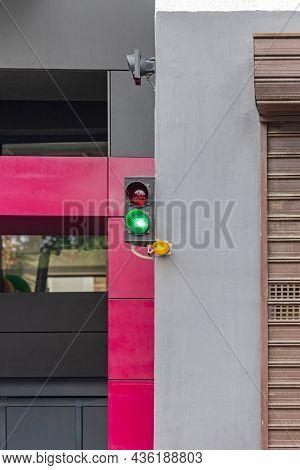 Green Light At Parking Entrance Building Exterior