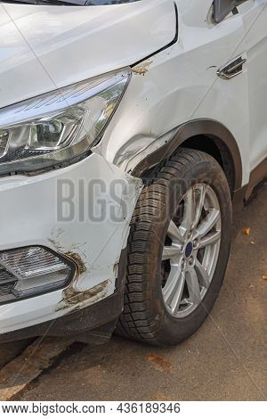 Traffic Accident Damage At Front Of New White Suv