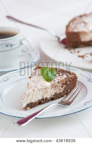 Beautiful Chocolate-raw Cheese Cake Ready To Eat With Cup Of Coffee, Main Focus On Mint Leaf