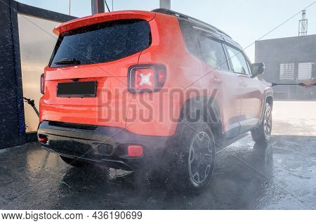 Car Wash With High Pressure Water. Professional Cleaning And Car Cleaning