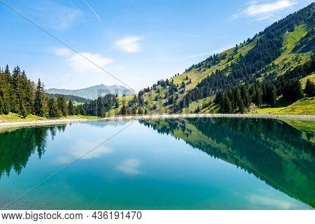 Lake Of Balme And Mountain Landscape In La Clusaz, Haute-savoie, France