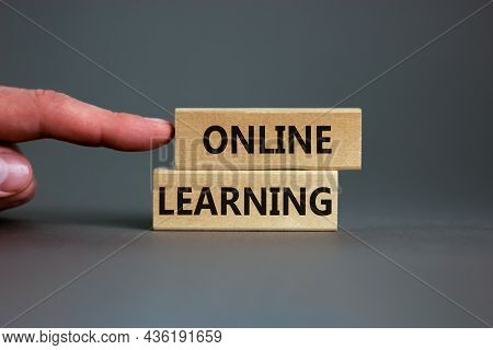 Online Learning Symbol. Concept Words 'online Learning' On Wooden Blocks On A Beautiful Grey Backgro