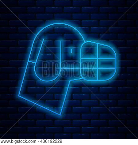 Glowing Neon Line Dog In Muzzle Icon Isolated On Brick Wall Background. Accessory For Dog. Vector