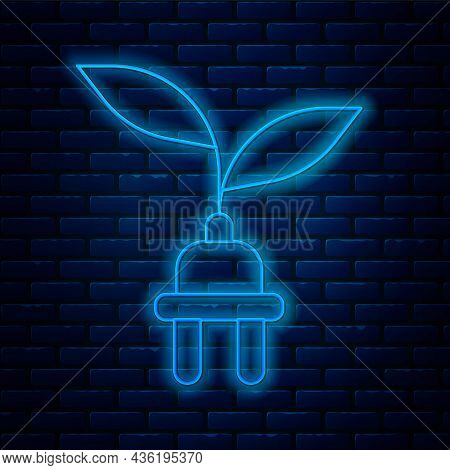 Glowing Neon Line Electric Saving Plug In Leaf Icon Isolated On Brick Wall Background. Save Energy E