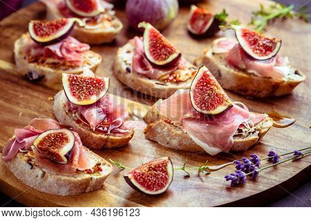 Small open sandwiches with ciabatta, proscuitto and fresh figs as appetizes