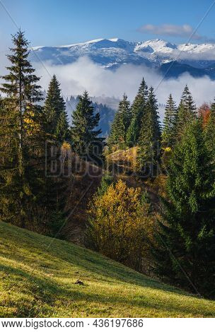 Late Autumn Mountain Morning Scene With Snow Covered Tops In Far And Foggy Clouds In Valleys. Pictur