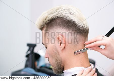 Straight Razor. Haircut Process Of Blond Young Man In Barbershop Salon, Barbershop Concept For Men A