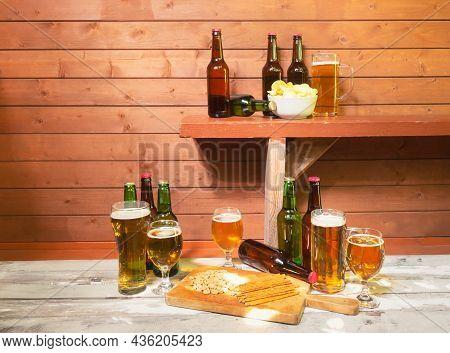 Beer Bottles, Bowl Of Potato Chips And Beer Mug On Bench, Glasses Of Beer, Mug Of Beer, Peanuts, Sal