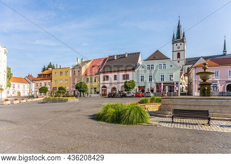 Tachov, Czech Republic - July 24, 2021: Colorful Houses, Fountain And Church On Republic Square In T