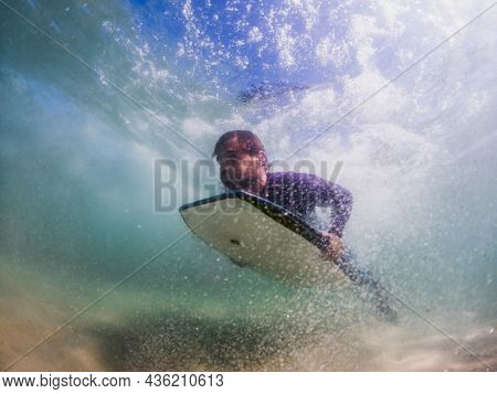 Bodyboarder Duck Diving A Wave