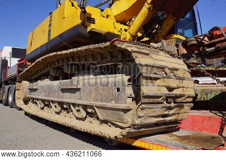 A Truck With A Special Semi-trailer For Transporting Oversized Loads. Transport Of A Huge Bulldozer.