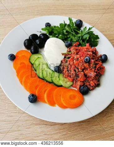 Piece Of Mocarella Cheese, Black Olives, Various Colorful Vegetables And Blueberries