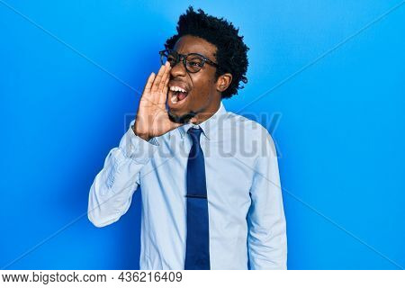 Young african american man wearing business clothes shouting and screaming loud to side with hand on mouth. communication concept.