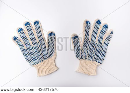 Construction Worker Protective Knitted Dotted Gloves On White Background, Hand Protection And Safety