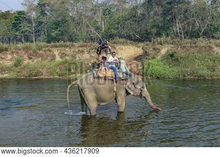 Chitwan, Nepal - March 31, 2014: People On An Elephant Safari At Chitwan National Park In Nepal.
