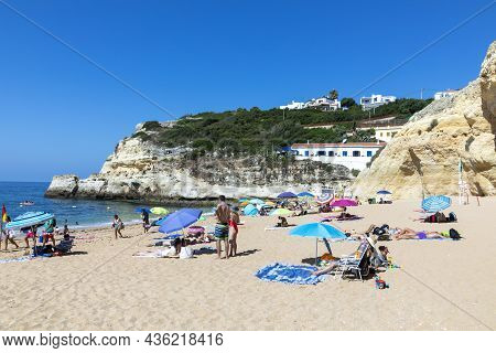 Carvoeiro, Portugal - July 13. 2020: People Enjoy The Scenic Beach At The Algarve Coast Near Carvoei