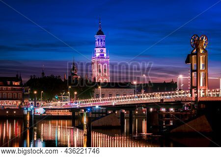 River Bridge In The Historical City Of Kampen, Overijssel, Netherlands By Night